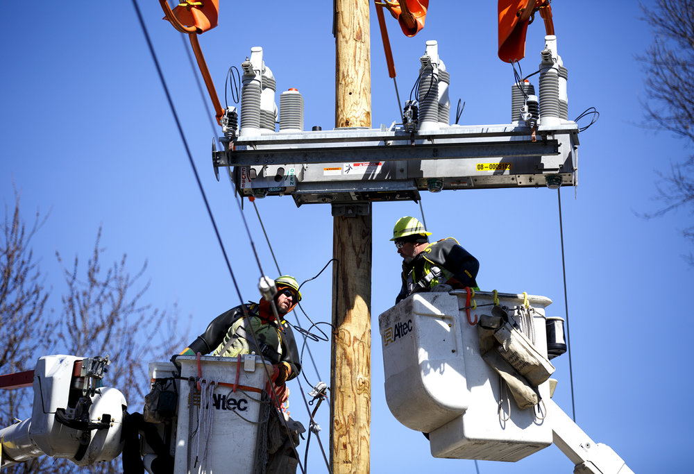 Jeremy Carron, left, and Eric Horsthenke, linemen for Ameren, install a smart technology circuit breaker called an IntelliRuptor, on a residential line in Taylorville Wedensday, March 22, 2017. [Rich Saal/The State Journal-Register]