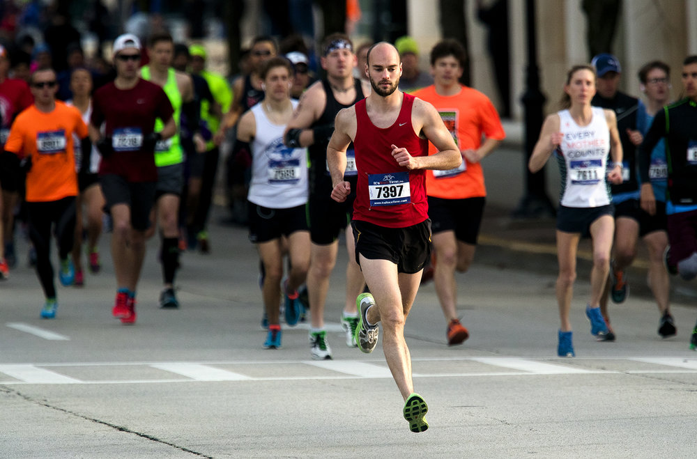 Timothy Shepherd takes off at a quick pace on his way to the overall title during the Lincoln Presidential Half Marathon in Springfield Saturday, April 1, 2017. Shepherd finished first in 1 hour 14 minutes 39.8 seconds. [Ted Schurter/The State Journal-Register]