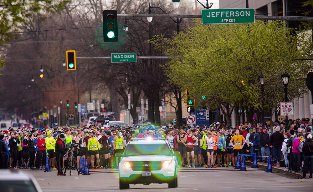 Runners line up behind the between on Sixth Street between Madison and Jefferson Streets before the start of the Lincoln Presidential Half Marathon in Springfield Saturday, April 1, 2017. Ted Schurter/The State Journal-Register
