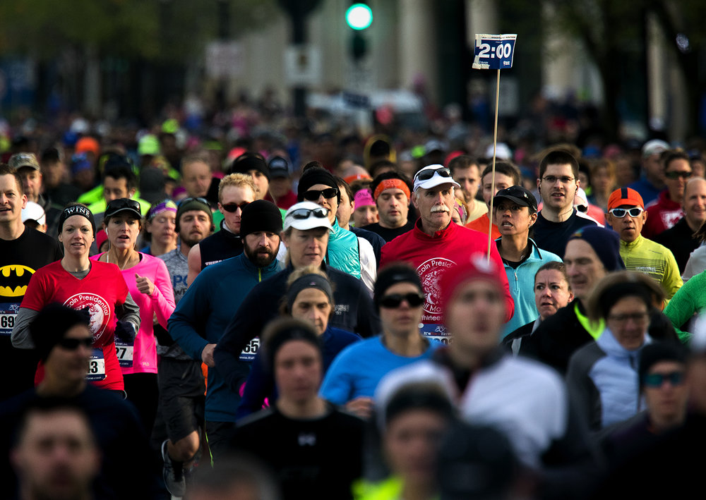 Runners make their way down Sixth Street at the start of the Lincoln Presidential Half Marathon in Springfield Saturday, April 1, 2017. [Ted Schurter/The State Journal-Register]