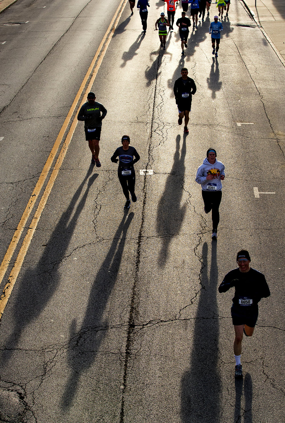 Runners make their way down Capitol Avenue during the Lincoln Presidential Half Marathon in Springfield Saturday, April 1, 2017. [Ted Schurter/The State Journal-Register]