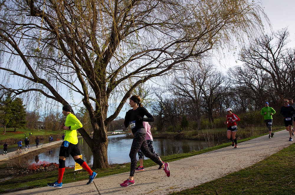 Runners make their way through Washington Park during the Lincoln Presidential Half Marathon in Springfield Saturday, April 1, 2017. [Ted Schurter/The State Journal-Register]