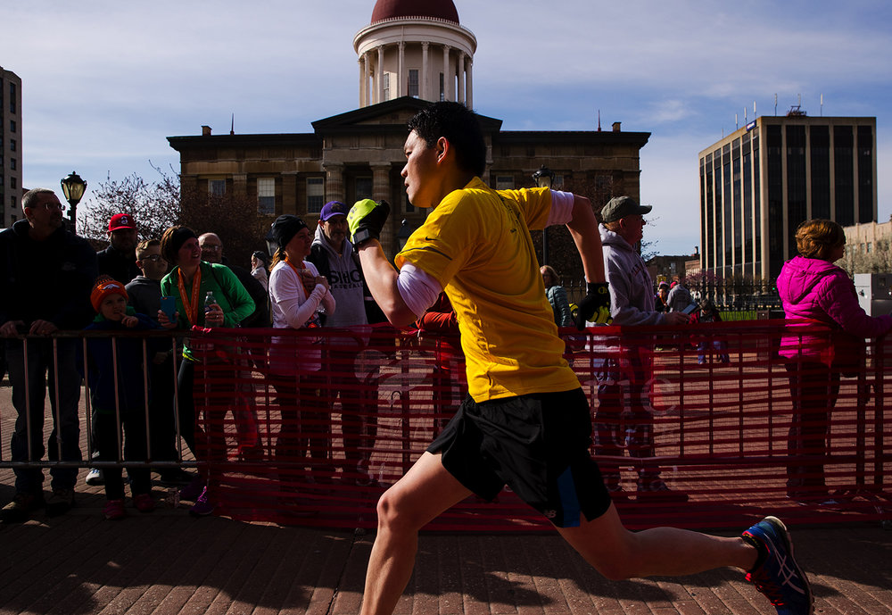 A runner sprints for the finish during the Lincoln Presidential Half Marathon in Springfield Saturday, April 1, 2017. [Ted Schurter/The State Journal-Register]