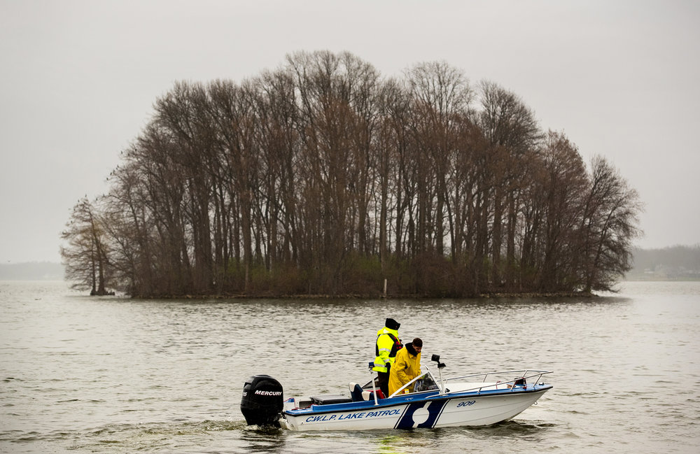 City Water Light and Power lake security personnel Thomas Carver and Scott Sandberg said the search for a missing person who went out on a personal watercraft early Sunday and never returned resumed Monday, March 27, 2017. The search is being carried out by the Springfield Police Department in partnership with other agencies, including CWLP Lake Patrol, Illinois Department of Natural Resources and Sangamon County Search and Rescue. [Ted Schurter/The State Journal-Register]
