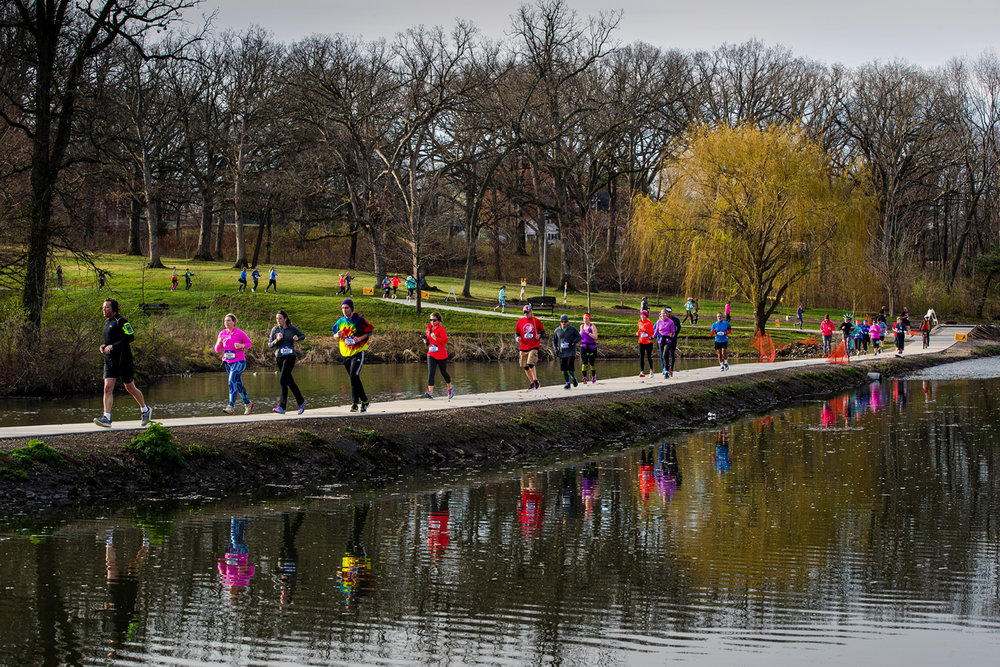 Runners make their way between the lagoons at Washington Park during the Lincoln Presidential Half Marathon in Springfield Saturday, April 1, 2017. [Ted Schurter/The State Journal-Register]