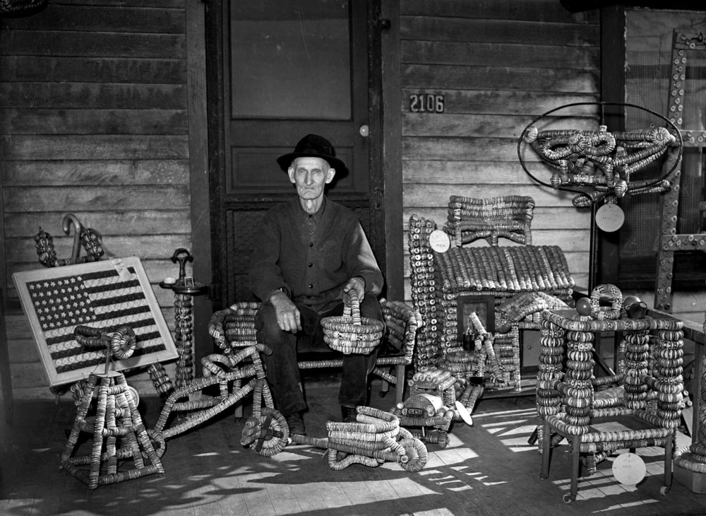 Robert Williams was a botle cap artist and exhibited his creations at the Illinois State Fair in 1941. Williams was photographed for the Illnois State Journal April 25, 1941.  file/The State Journal-Register