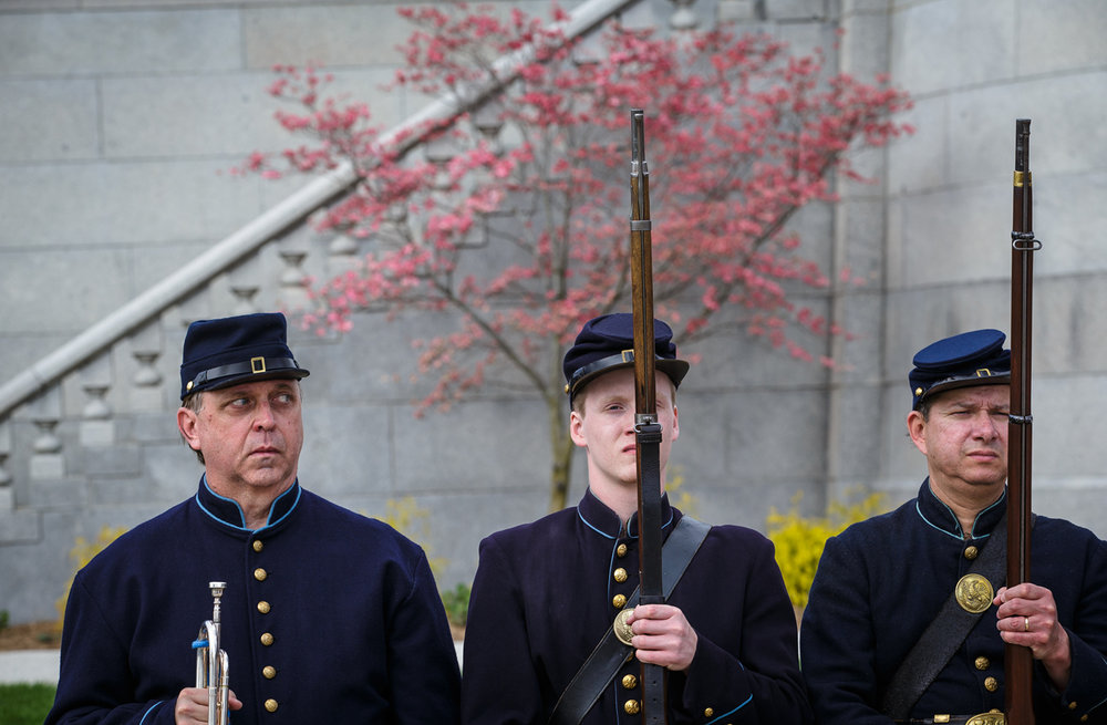 "Paul Vandevoort, left, waits for his cue to play ""Taps"" along with Ryan Morrow, center, and Shaun Riedell, right, with the 114th Regiment Illinois Volunteer Infantry Reactivated during the 61st annual Lincoln Tomb Ceremony commemorating the anniversary of the death of Abraham Lincoln at Oak Ridge Cemetery, Saturday, April 15, 2017, in Springfield, Ill. [Justin L. Fowler/The State Journal-Register]"