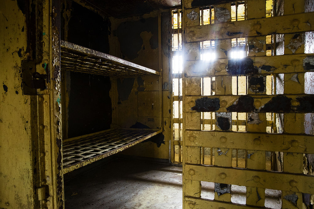 Each cell in the 1869 Macoupin County Jail, known as the Cannonball Jail, in Carlinville, Ill., featured two bunks. Route 66 preservation groups have joined local efforts to restore and reopen the jail. [Ted Schurter/The State Journal-Register]