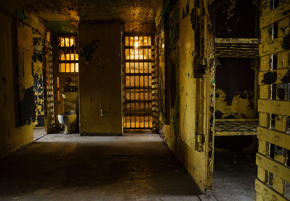 Male inmates shared a single toliet in the first floor cellblock of the 1869 Macoupin County Jail, known as the Cannonball Jail, in Carlinville, Ill.. Route 66 preservation groups have joined local efforts to restore and reopen the jail. [Ted Schurter/The State Journal-Register]