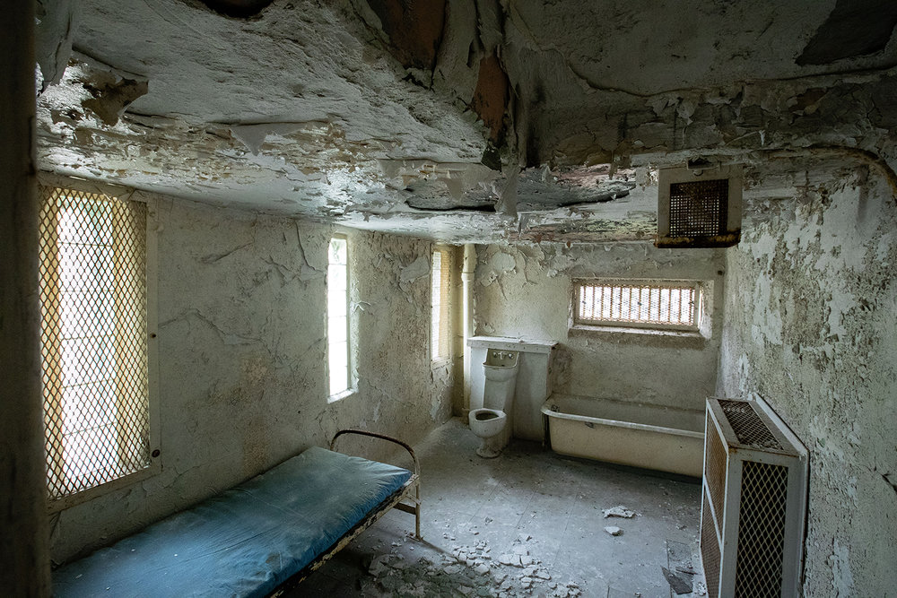 The women's cell in the 1869 Macoupin County Jail, known as the Cannonball Jail, in Carlinville, Ill., featured a single bunk. Route 66 preservation groups have joined local efforts to restore and reopen the jail. [Ted Schurter/The State Journal-Register]