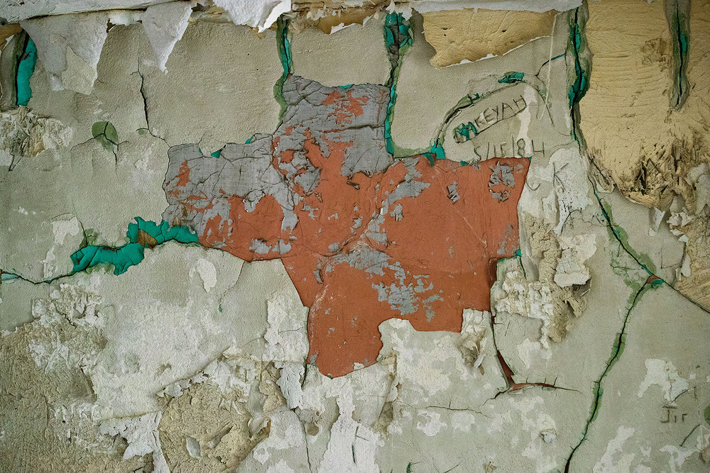 Layers of paint and plaster peel off the wall and ceiling of the women's cell  in the 1869 Macoupin County Jail, known as the Cannonball Jail, in Carlinville, Ill.. Route 66 preservation groups have joined local efforts to restore and reopen the jail. [Ted Schurter/The State Journal-Register]