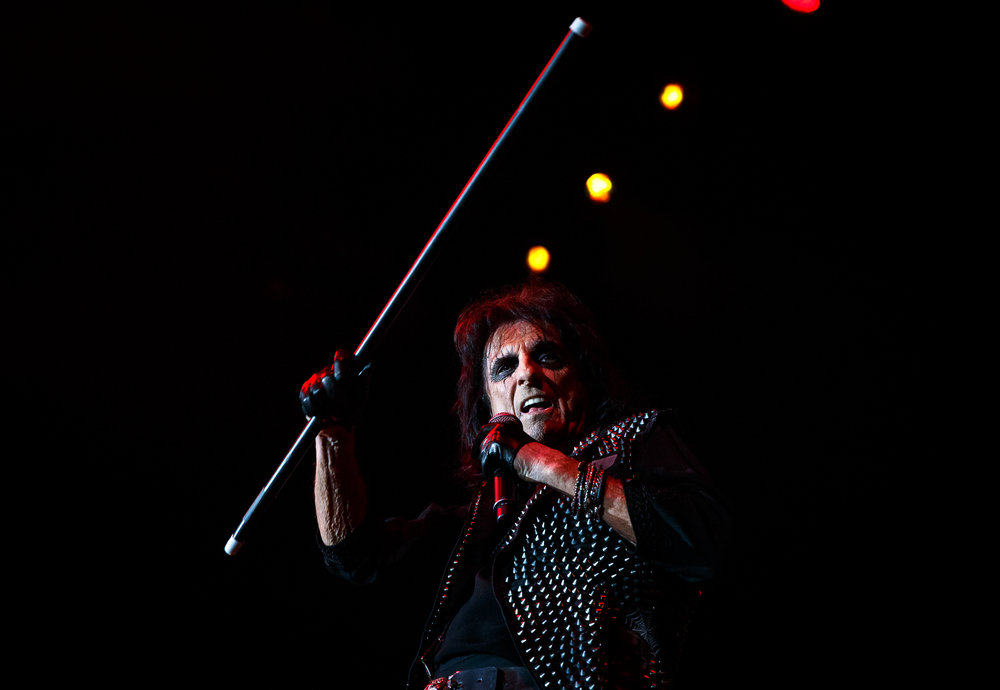 "Alice Cooper performs the song ""Brutal Planet"" with his signature cane at the Prairie Capital Convention Center, Sunday, April 23, 2017, in Springfield, Ill. [Justin L. Fowler/The State Journal-Register]"