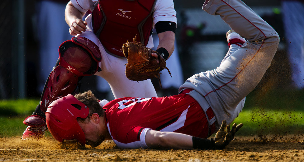 Jacksonville's Scott Huckabay loses his helmet as he slides into homeplate after being tagged by Glenwood catcher Jake Ryan at Community Park in Chatham Wednesday, April 19, 2017. [Ted Schurter/The State Journal-Register]