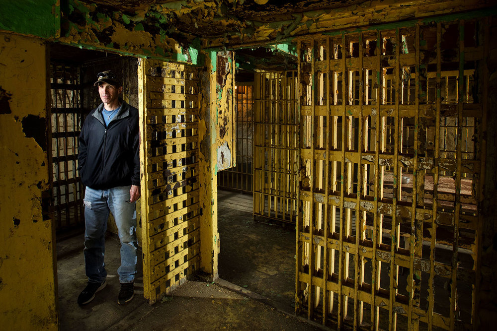 Macoupin County Board member Harry Starr stands in one of the cell blocks at the 1869 Macoupin County Jail, known as the Cannonball Jail, in Carlinville, Ill., Friday, April 21, 2017. Route 66 preservation groups have joined local efforts to restore and reopen the jail as a well-known spot in the road's heyday as a popular route between St. Louis and Chicago, including travel for ill-gotten gains. Research of jail records by the Macoupin County Historical Society found references to the Prohibition-era bootlegging operations of Chicago gangster Al Capone. Legend has it Route 66 was created and paved in the 1920s partly as a result of lobbying by the Chicago syndicate. [Ted Schurter/The State Journal-Register]