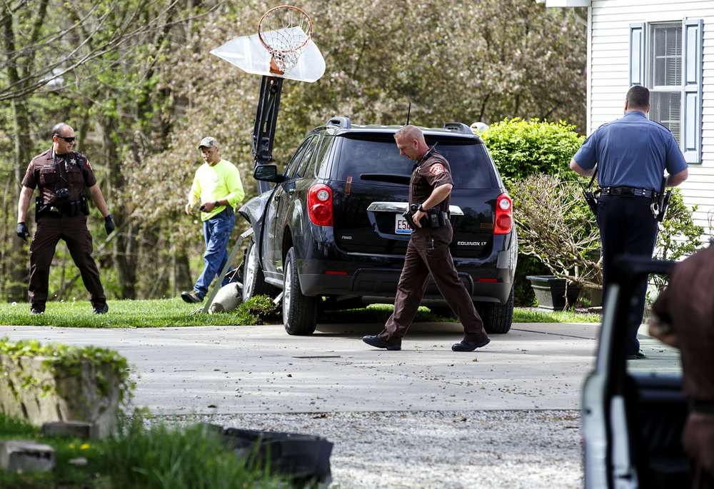 The car driven by a man suspected of a robbing a bank in Lincoln came to rest in the driveway of a home on the dead end of Vincent Street on Springfield's northeast side after Sangamon County sheriff's deputies spotted the car and gave chase Monday, April 17, 2017. [Rich Saal/The State Journal-Register]