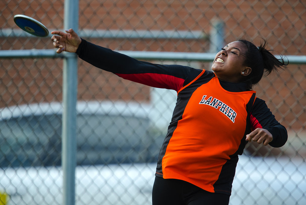Lanphier's Velencia throws the discuss 104-09, good for first place during the Girls City Meet at Memorial Stadium Tuesday, April 25, 2017.  [Ted Schurter/The State Journal-Register]