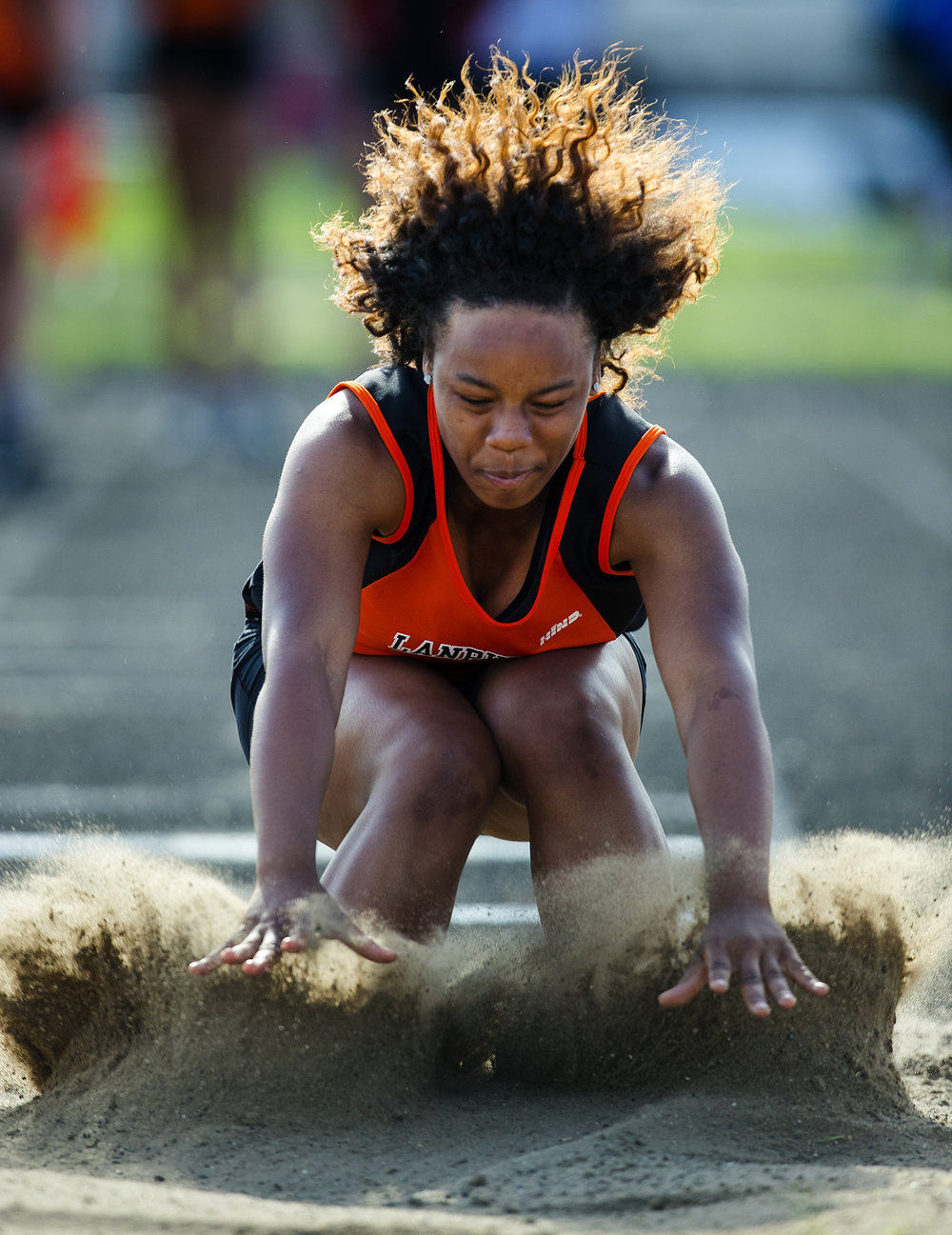 Lanphier's Mariyah Milford competes in the long jump during the Girls City Meet at Memorial Stadium Tuesday, April 25, 2017.  [Ted Schurter/The State Journal-Register]