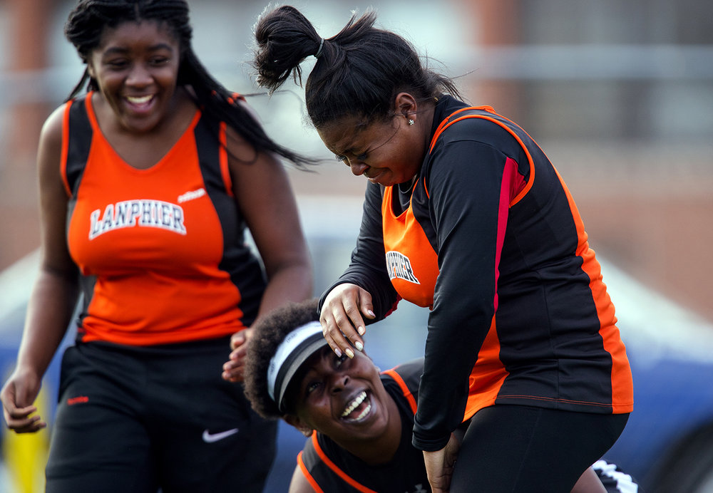 Lanphier's Velencia Johnson reacts after learning her distance in the discuss, 104-09, was her personal best of the season and good for first place during the Girls City Meet at Memorial Stadium Tuesday, April 25, 2017.  [Ted Schurter/The State Journal-Register]