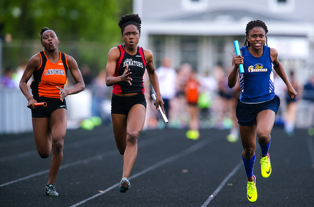 Springfield's Ozzy Erewele edges Lanphier's Martrice Brooks, left, and Southeast's Serena Bolden in the 4x100 meter relay 