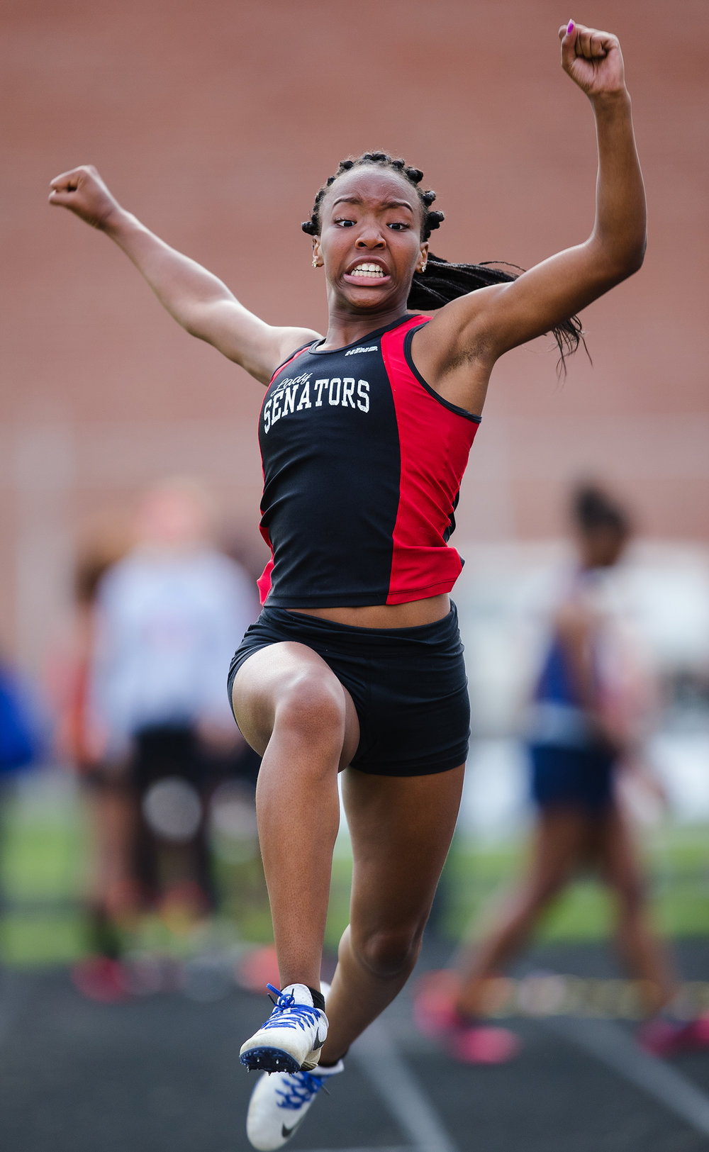 Springfield's Ashanti Hanson competes in the triple jump during the Girls City Meet at Memorial Stadium Tuesday, April 25, 2017.  [Ted Schurter/The State Journal-Register]