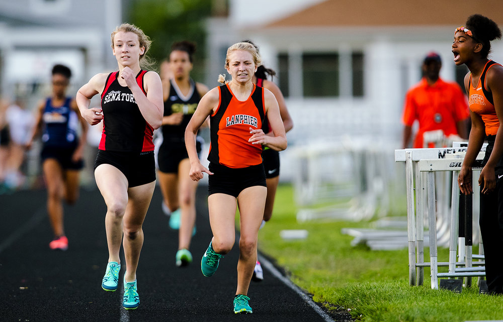 Springfield's Abby Norris passes Lanphier's Bre Rainey for the win in the final seconds of the 800 meter run during the Girls City Meet at Memorial Stadium Tuesday, April 25, 2017.  [Ted Schurter/The State Journal-Register]