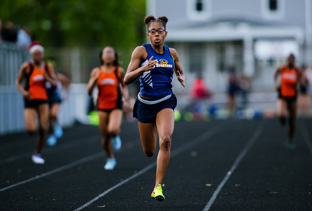 Southeast's Raven Moore sets a new meet record of 56.56 seconds in the 400 meter race during the Girls City Meet at Memorial Stadium Tuesday, April 25, 2017.  [Ted Schurter/The State Journal-Register]