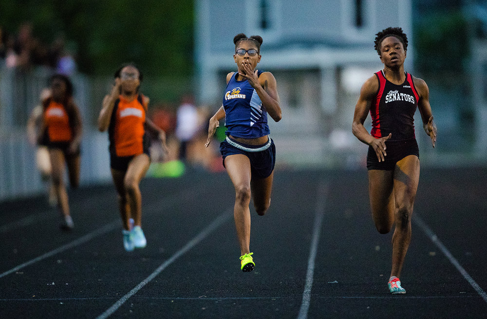 Springfield's Ozzy Erewele edges Southeast's Raven Moore in the 200 meter dash during the Girls City Meet at Memorial Stadium Tuesday, April 25, 2017.  [Ted Schurter/The State Journal-Register]