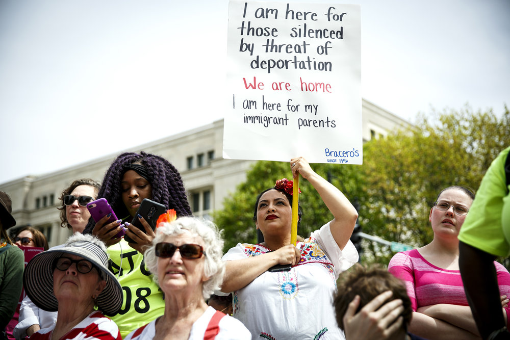Joann Flores-Deter supports rights for immigrants at the Illinois Women March on Springfield rally at the Capitol in Springfield, Ill. Tuesday, April 25, 2017.  [Rich Saal/The State Journal-Register]