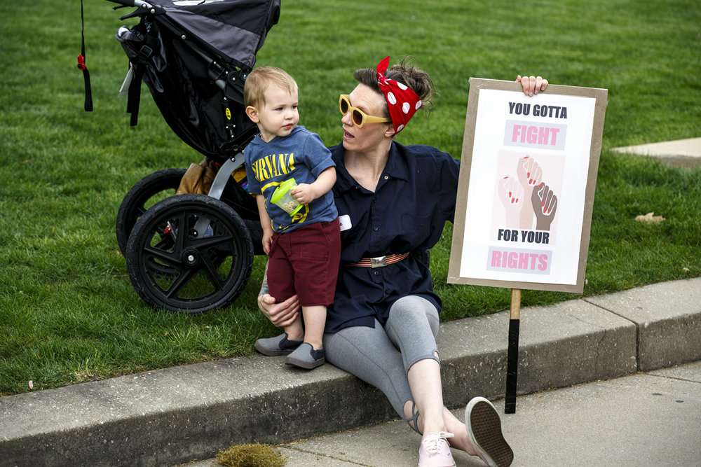 Bryanna Bertolino and her son, Finn Larson, attended the Illinois Women March on Springfield rally at the Capitol in Springfield, Ill. Tuesday, April 25, 2017. [Rich Saal/The State Journal-Register]
