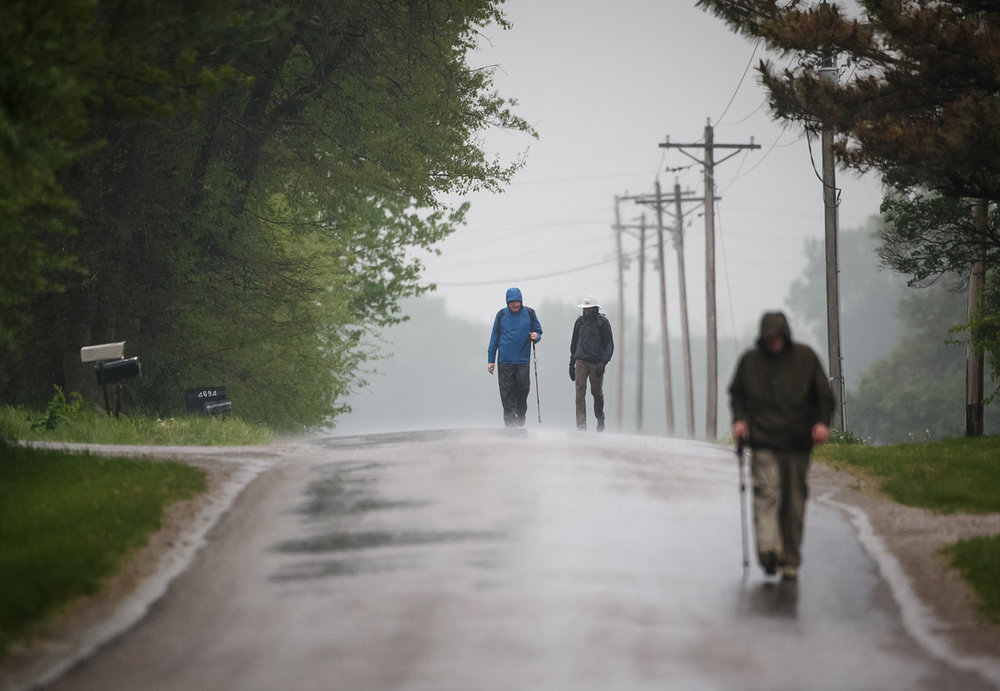 After departing at 6 a.m. Boy Scout supporters Gary Schwab, left, and Nasar Nallamothu, right, were part of the front runners to be early finishers during the Lincoln Trail HIke, Saturday, April 29, 2017, north of Springfield, Ill. The 19-mile hike takes Boy Scouts from New Salem Historic Site to Stuart Park in Springfield. [Justin L. Fowler/The State Journal-Register]