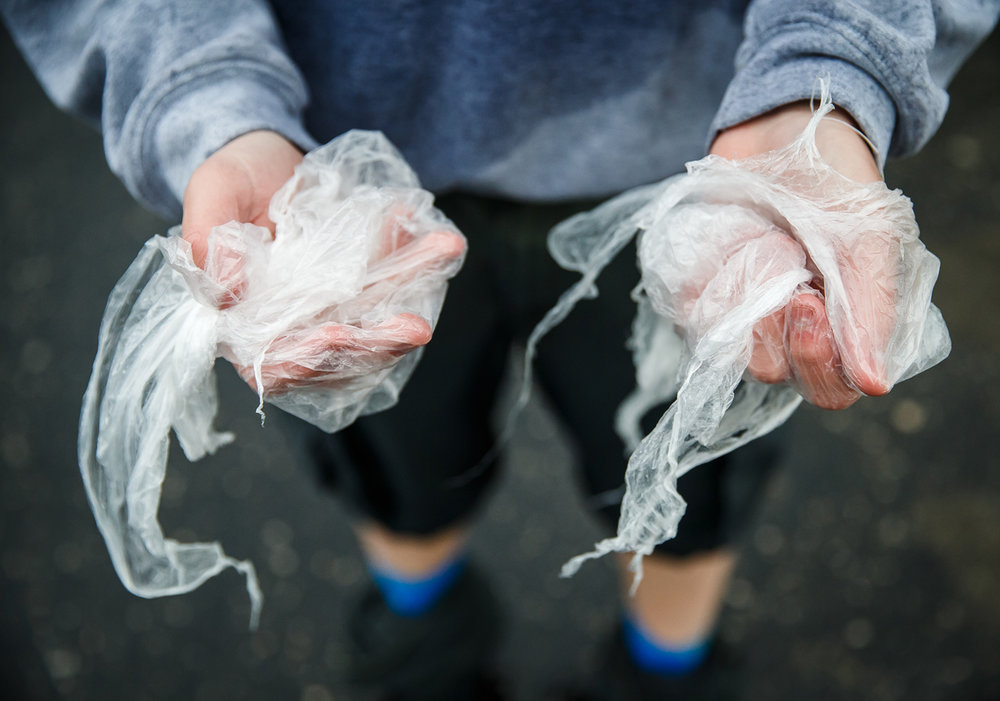 Kyle Haschemeyer, a member of Troop 210, used plastic bags wrapped around his hands to keep them warm during the Lincoln Trail Hike, Saturday, April 29, 2017, in Springfield, Ill. The 19-mile hike takes Boy Scouts from New Salem Historic Site to Stuart Park in Springfield. [Justin L. Fowler/The State Journal-Register]
