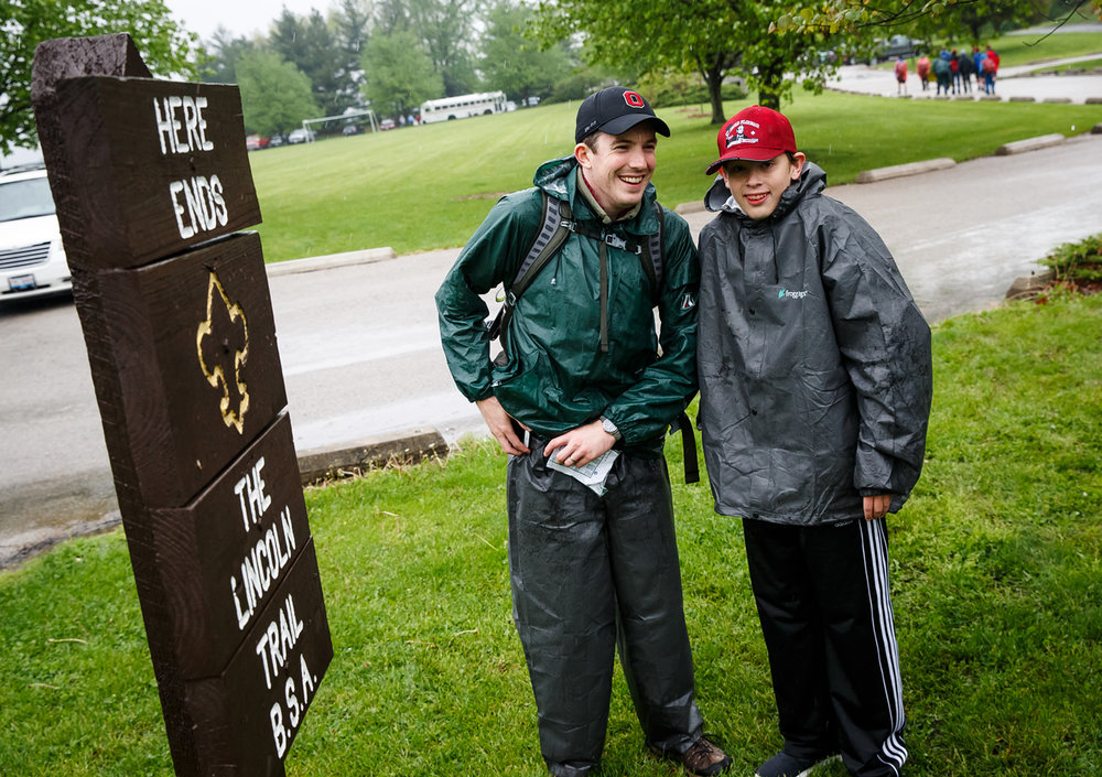 Despite the day of pouring rain Matt Stephens-Rich, left, of Columbus, Ohio, and his nephew Eric Drummond, of Tucson, Ariz., reach the finish of the 19-mile Lincoln Trail Hike in Stuart Park, Saturday, April 29, 2017, in Springfield, Ill. Stephens-Rich and Drummond are fifth and sixth generation decedents of R. Allan Stephens, a former Springfield Boy Scout commissioner, who helped create the Lincoln Trail Hike in 1926. [Justin L. Fowler/The State Journal-Register]