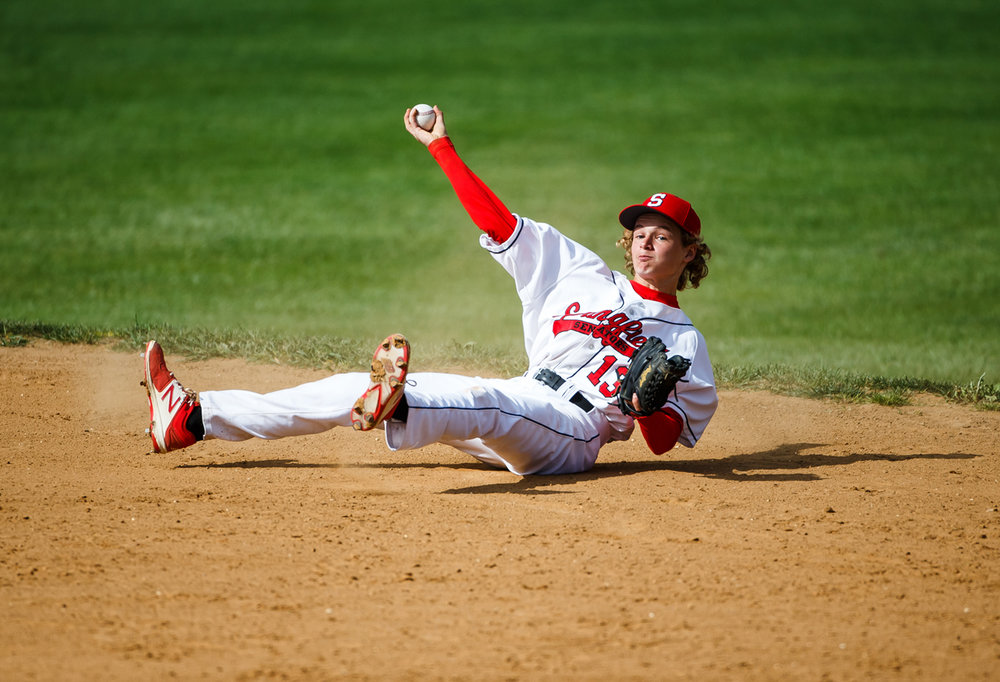 Springfield's Jacks Hyde (13) tries to make the throw to first from a ground ball after hitting the dirt fielding the hit from Sacred Heart-Griffin in the second inning during the City Series at Robin Roberts Stadium, Thursday, April 27, 2017, in Springfield, Ill. [Justin L. Fowler/The State Journal-Register]