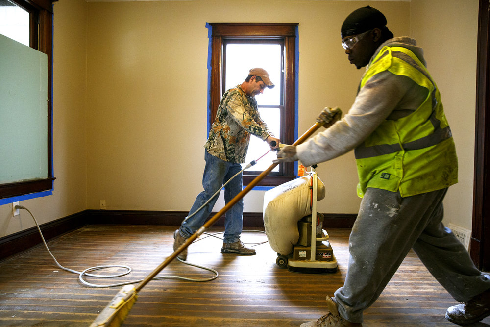 Terry Wessing, left, and Donald Newton work on floors Friday, April 28, 2017  in a home at 936 N. 3rd St. being renovated by the Enos Park Neighborhood Association. The home was purchased using TIF funds. [Rich Saal/The State Journal-Register]