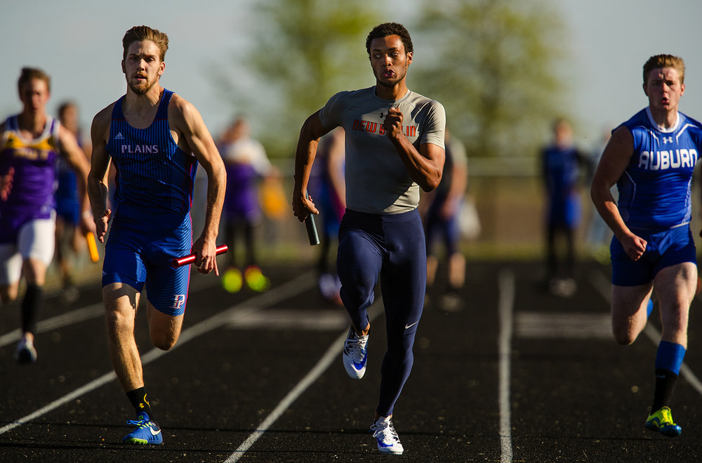 New Berlin's Wassell glances over as he takes the lead during the anchor leg of the 4x100 meter relay during the Sangamon County Track Meet at Williamsville High School Friday, May5, 2017.  [Ted Schurter/The State Journal-Register]
