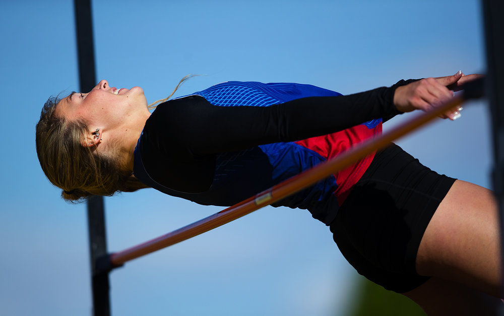 Pleasant Plains' Lauren Feagans competes in the high jump during the Sangamon County Track Meet at Williamsville High School Friday, May5, 2017. Feagans won the event. [Ted Schurter/The State Journal-Register]