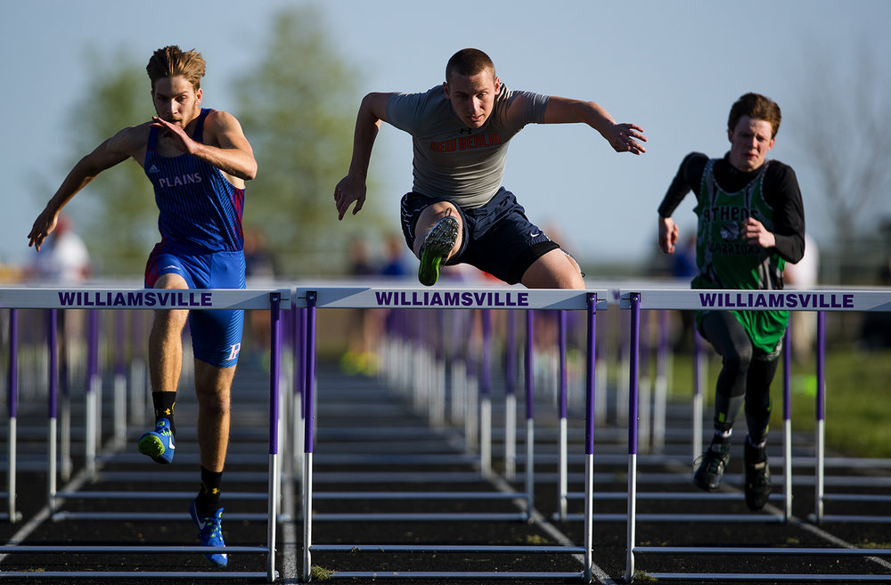 New Berlin's Evan Gustafson wins the 110 High Hurdles during the Sangamon County Track Meet at Williamsville High School Friday, May5, 2017.  [Ted Schurter/The State Journal-Register]