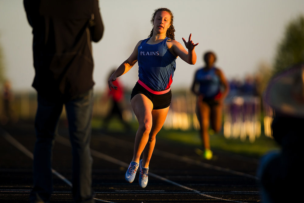 Pleasant Plains' Alli Morley wins the 200 meter dash during the Sangamon County Track Meet at Williamsville High School Friday, May5, 2017.  [Ted Schurter/The State Journal-Register]