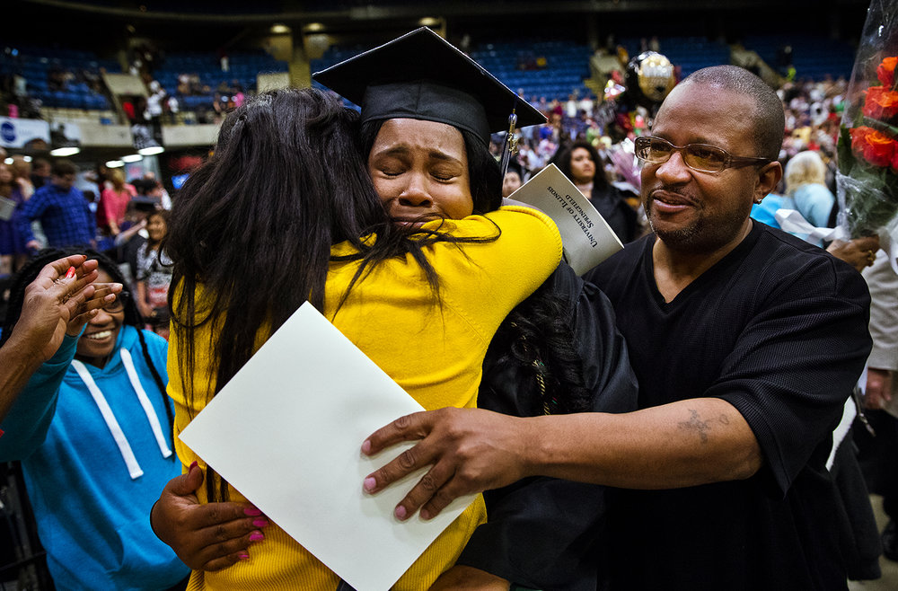 University of Illinois Springfield graduate Charmynne Itson is embraced by her sister Danitra Williams and brother Danardo Triplett after commencement ceremonies for the College of Liberal Arts and Sciences at the Prairie Capital Convention Center Saturday, May 13, 2017. [Ted Schurter/The State Journal-Register]