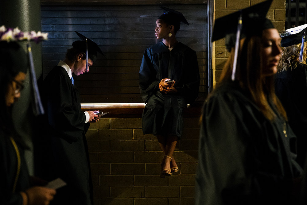 Aziza McNeese of Springfield waits in the wings with other soon-to-be graduates for the  commencement ceremonies for the College of Liberal Arts and Sciences to commence at the Prairie Capital Convention Center Saturday, May 13, 2017. [Ted Schurter/The State Journal-Register]