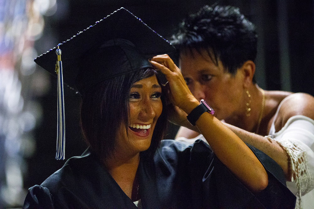Kiara Sidener holds her cap as her mom Chara Garcia adjusts her hair before the commencement ceremonies for the College of Liberal Arts and Sciences at the Prairie Capital Convention Center Saturday, May 13, 2017. [Ted Schurter/The State Journal-Register]