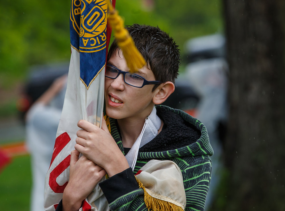Kyle White, 12, of Jacksonville, Ill., with Troop 113, looks after his troops flags as the rain comes down during the 72nd annual Lincoln Pilgrimage by the Abraham Lincoln Council Boy Scouts of America at the Lincoln Tomb in Oak Ridge Cemetery, Sunday, April 30, 2017, in Springfield, Ill. [Justin L. Fowler/The State Journal-Register]