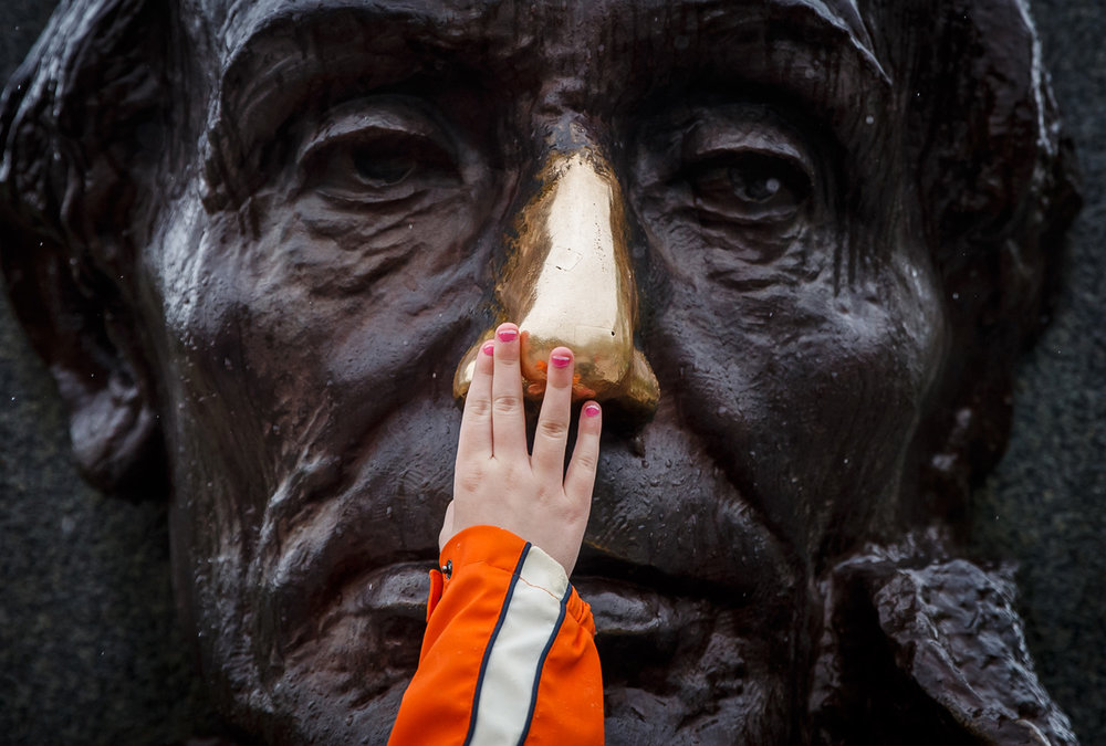 Despite the rain, Lincoln's nose was still getting attention from the Scouts in attendance during the 72nd annual Lincoln Pilgrimage by the Abraham Lincoln Council Boy Scouts of America at the Lincoln Tomb in Oak Ridge Cemetery, Sunday, April 30, 2017, in Springfield, Ill. [Justin L. Fowler/The State Journal-Register]