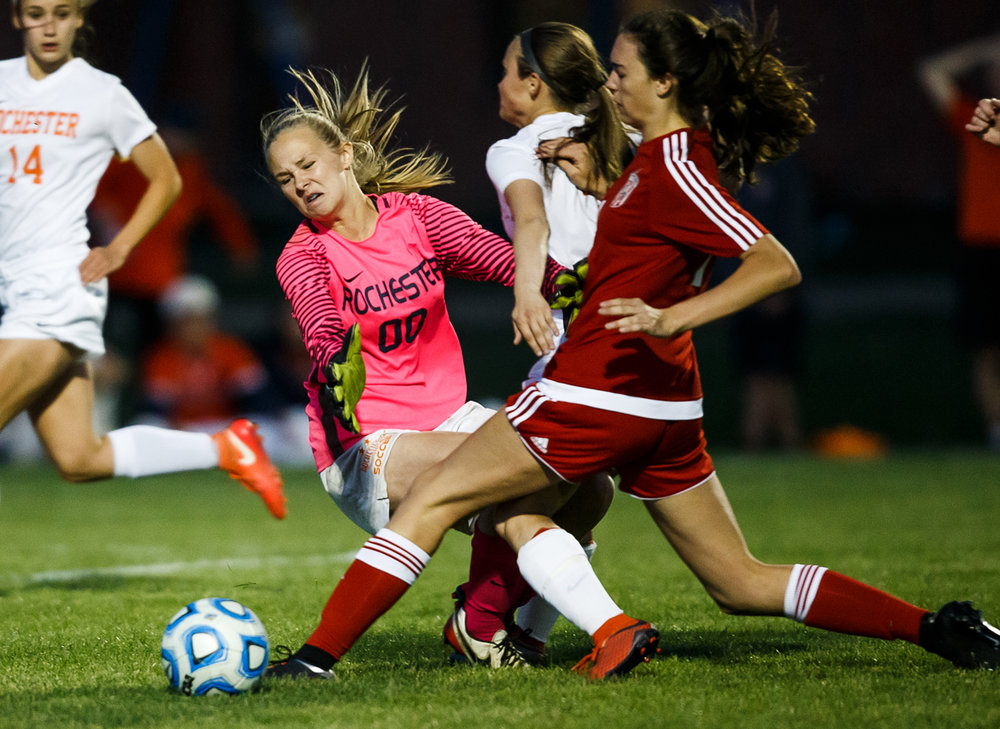 Rochester goal keeper Emily Wollet (00) collides with Glenwood's Carlie Smith (10) as she comes out of the box trying to stop a shot attempt in the first half at Rochester Elementary School, Tuesday, May 2, 2017, in Rochester, Ill. [Justin L. Fowler/The State Journal-Register]