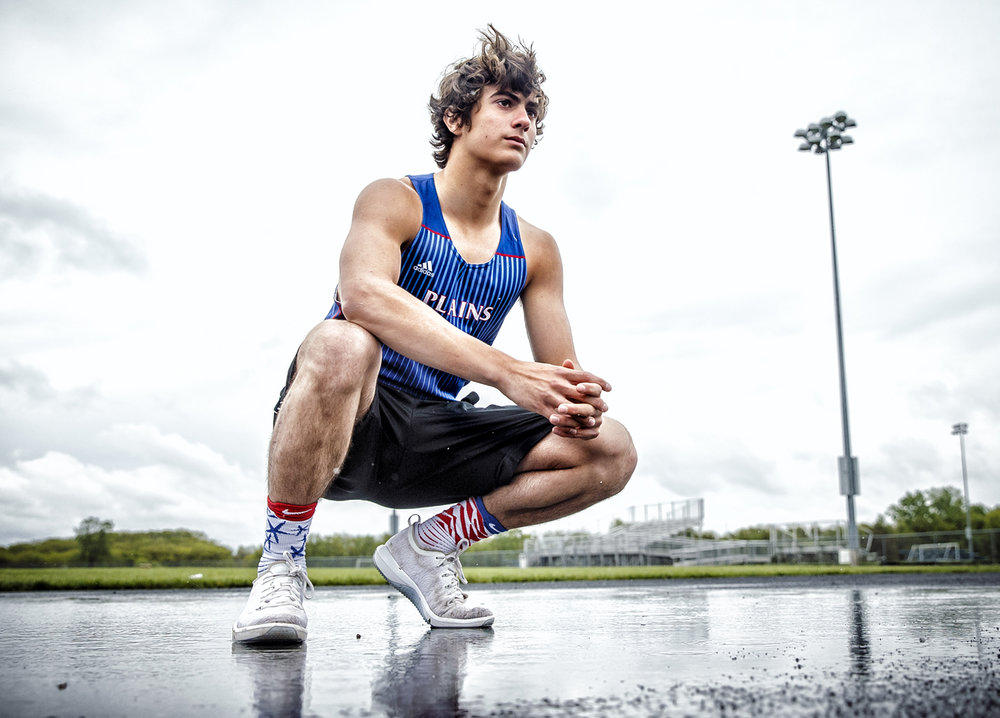 Sam McAfee suffered a double fracture in his lower right leg during a junior varsity football in 2015, but has come back from the injury to be a talented sophomore in the long jump, sprint relays and 100-meter dash. [Justin L. Fowler/The State Journal-Register]