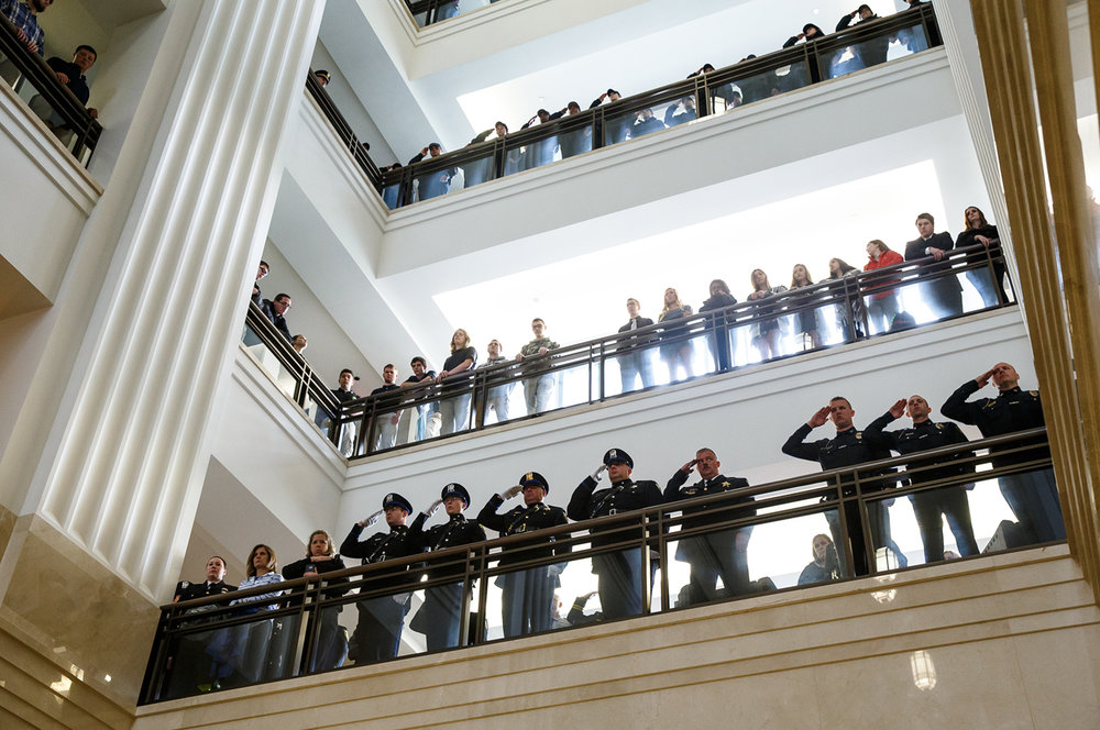 Officers stand attention on the upper levels of the Illinois State Library as the 32nd annual Police Officers Memorial Day was forced inside due to the rain, Thursday, May 4, 2017, in Springfield, Ill. [Justin L. Fowler/The State Journal-Register]