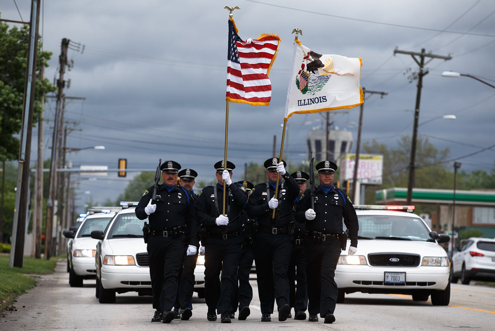 The Springfield Police Department Honor Guard marches down North 9th Street toward East Converse Street to honor Officer David Tapscott, a Springfield police officer who died while responding to a disturbance call in 1979, during a ceremony, Thursday, May 4, 2017, in Springfield, Ill. Tapscott died from his injuries after his vehicle collided with the center support pylon of the railroad overpass, that was recently removed, while responding to a call on Christmas Eve, 1979. [Justin L. Fowler/The State Journal-Register]