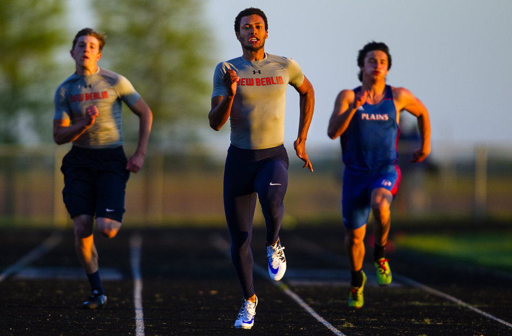 New Berlin's Wassell wins the 200 meter dash, his third personal title of the day, during the Sangamon County Track Meet at Williamsville High School Friday, May5, 2017.  [Ted Schurter/The State Journal-Register]