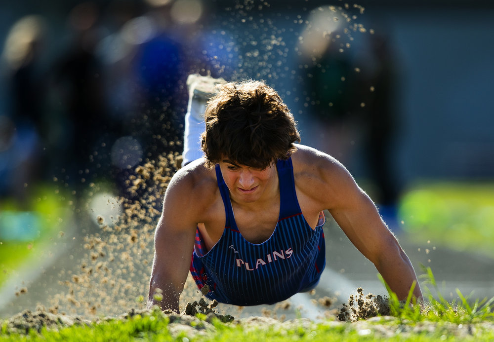 Pleasant Plains' Sam McAfee dives forward after landing in the pit during the long jump at the Sangamon County Track Meet at Williamsville High School Friday, May5, 2017. Trewes won the event. [Ted Schurter/The State Journal-Register]