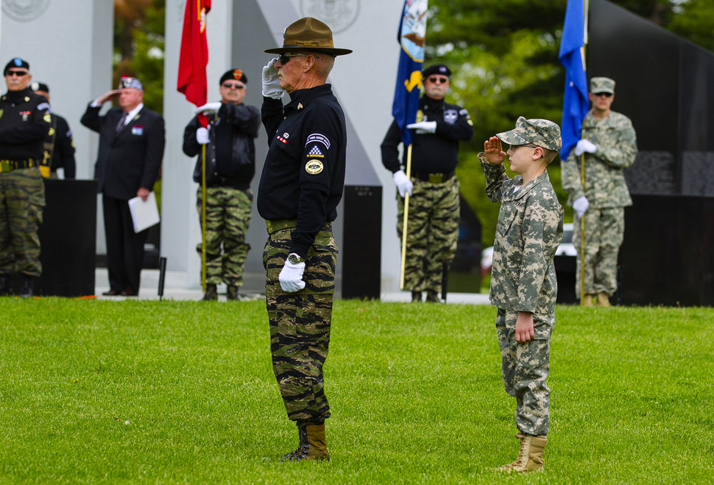 Bobby Harris, right, salutes along with his grandfather John Hensley as the colors are posted during the 29th annual Vietnam Veterans Memorial Vigil at the Illinois Vietnam Veterans Memorial at Oak Ridge Cemetery Saturday, May 6, 2017. [Ted Schurter/The State Journal-Register]